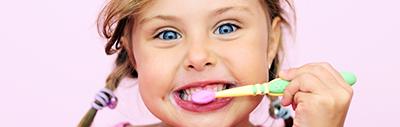 A Kid Brushing Her Teeth